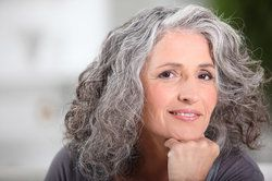 Attractive gray-haired woman with smooth skin