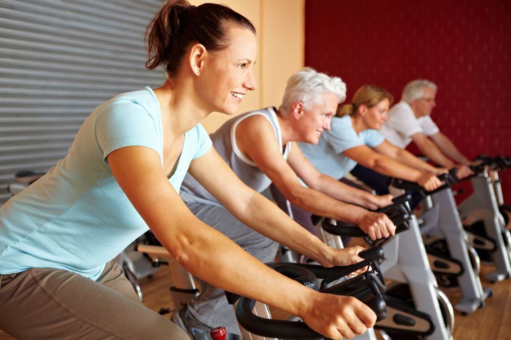 Image of people working out on stationary bikes