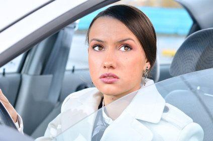 Woman in a sedan