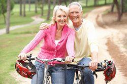 a couple taking a break from a bike ride