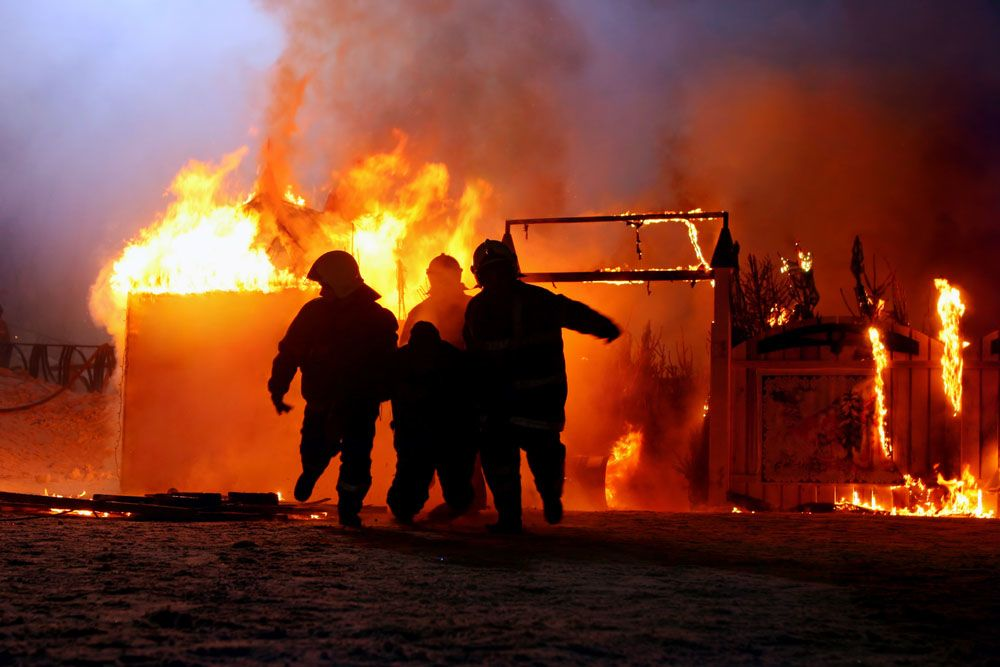 Firefighters and a burning house