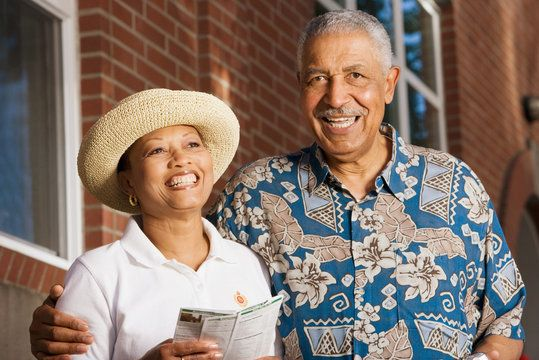 Smiling, middle-aged African American couple in vacation attire