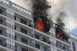 Fire consuming multi-story apartment building