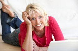 A middle-aged woman in front of a laptop