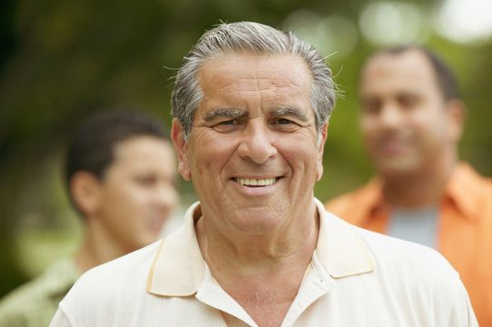 Elderly Caucasian man with gray hair, smiling with full set of teeth