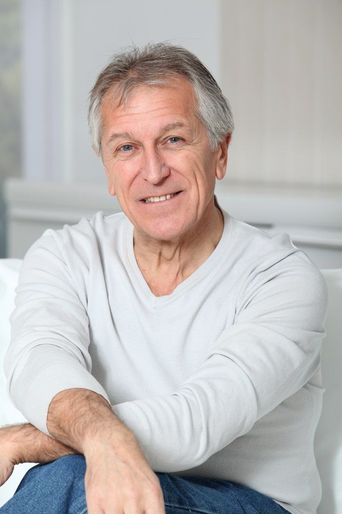 An elderly man with a healthy looking smile