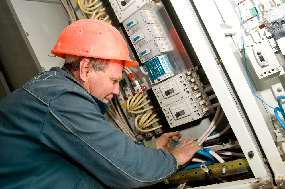 An electrician working with circuits on a construction site