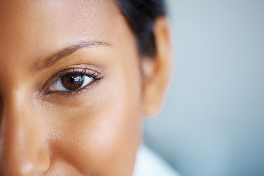 close up of woman with brown eye
