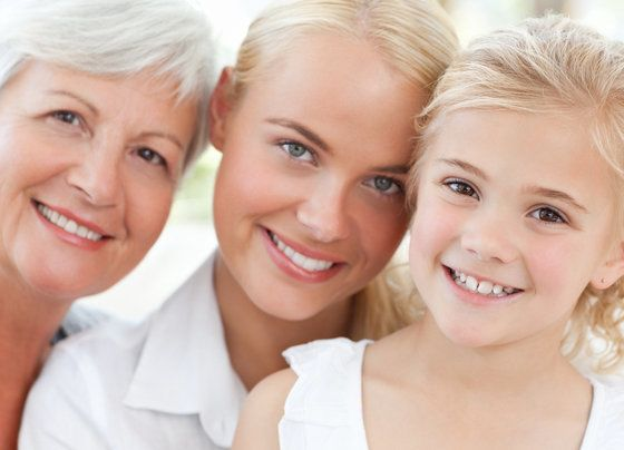 Grandmother, mother and daughter smiling together