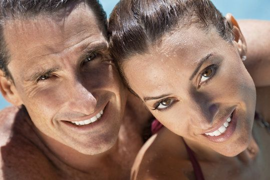 A very tan brunette man and woman close-up.