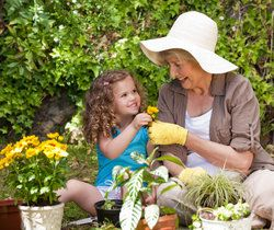 Grandmother and granddaughter potting plants