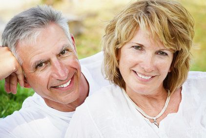 Smiling middle-aged couple posing together for picture