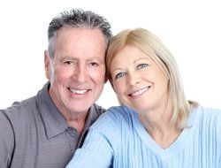 An older couple with smooth facial skin