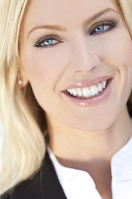 A blonde woman with a beautiful smile