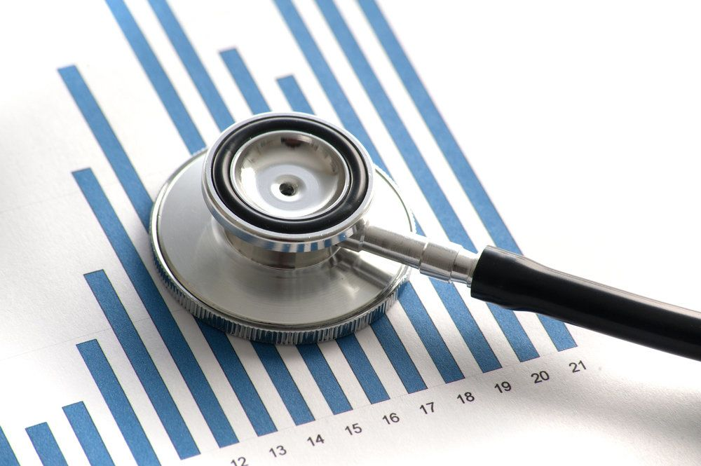 A stethoscope on a bar graph