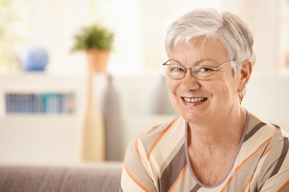 A woman at home smiling