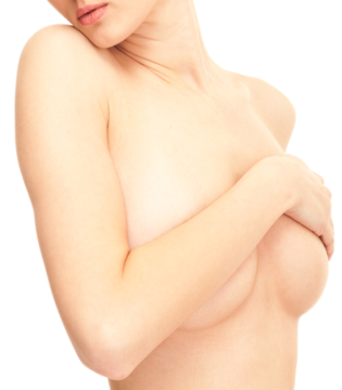 Woman holding arms across naked breasts and pushing chin against shoulder