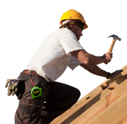 A construction worker up on a roof
