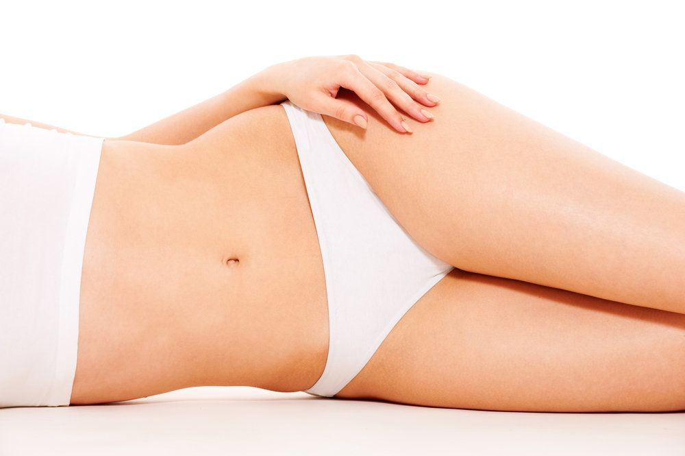 Woman with a slim, toned abdomen