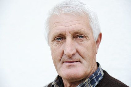Pensive looking elderly Caucasian man with blue eyes