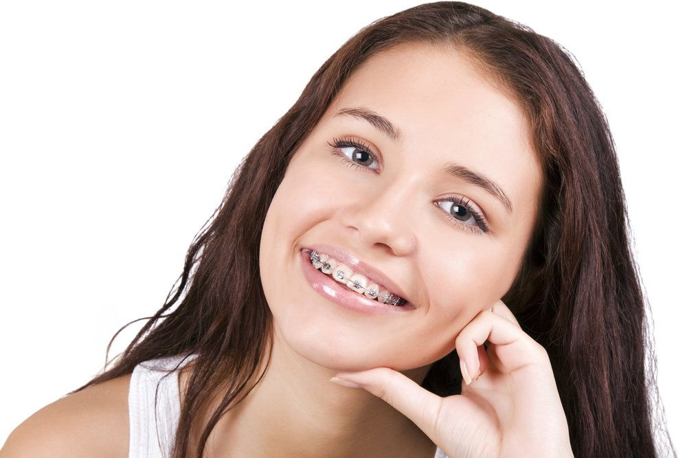 A teenage girl wearing braces