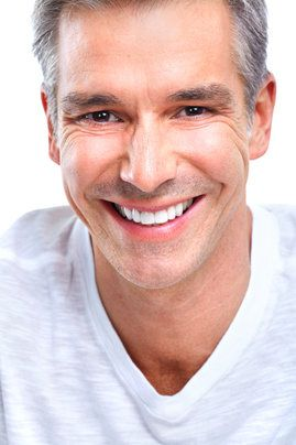 A middle-aged man with a bright and healthy smile