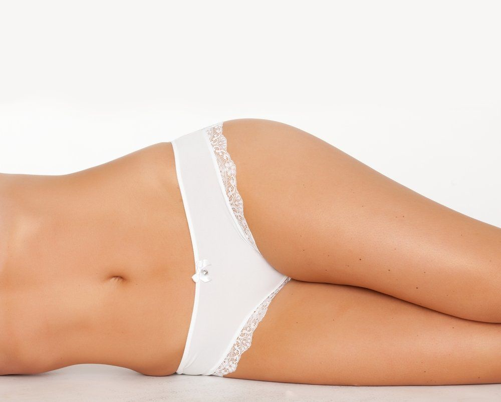 A woman wearing white panties