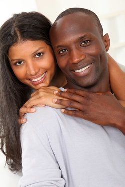 A man and woman with bright white smiles
