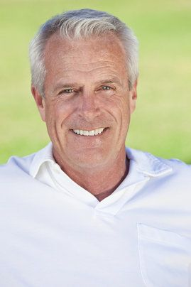 An older man with a healthy, attractive smile