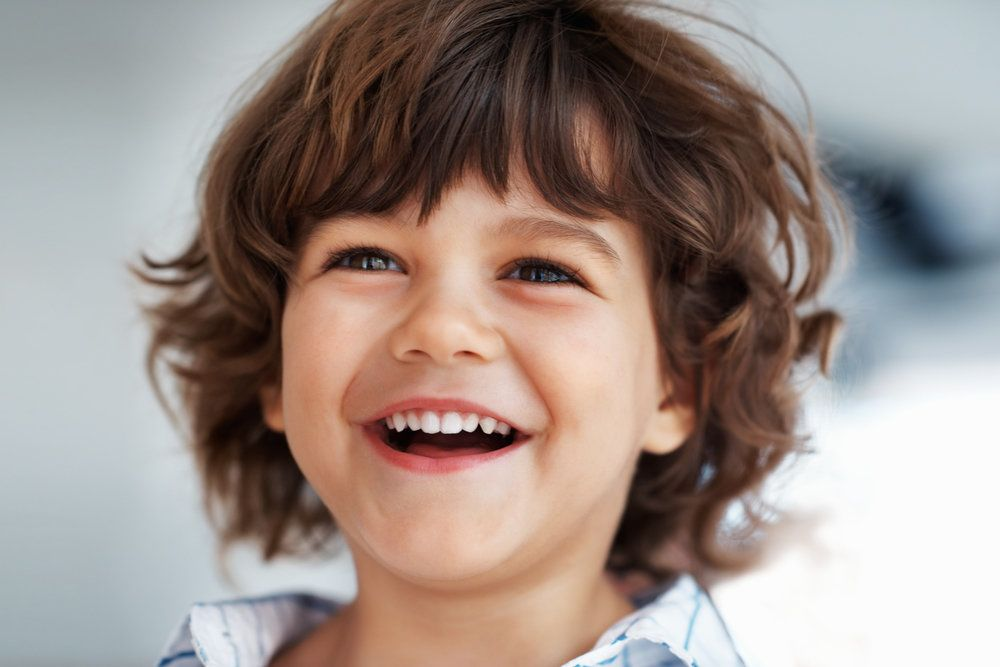 Smiling young boy in blue plaid shirt