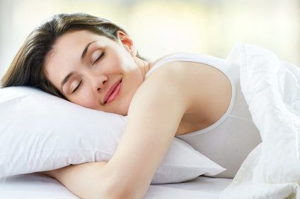 Relaxed sleeping brunette woman in white