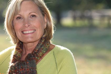 Smiling middle-aged woman in knit scarf