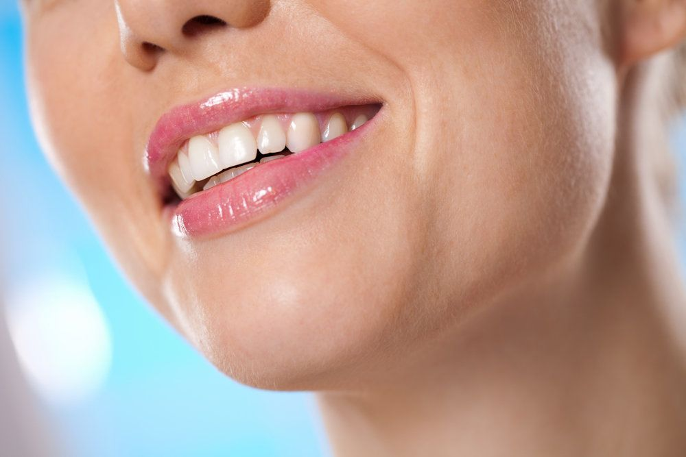 A woman shares a healthy smile