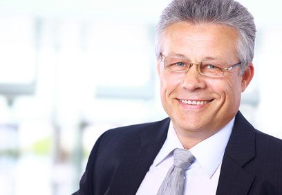 Smiling grey-haired businessman