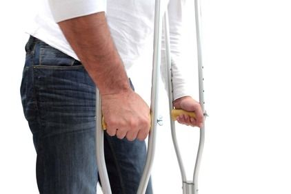 Partial view of man with crutches