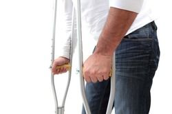 man standing with crutches