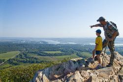 Father and son hiking and looking at picturesque landscape from afar