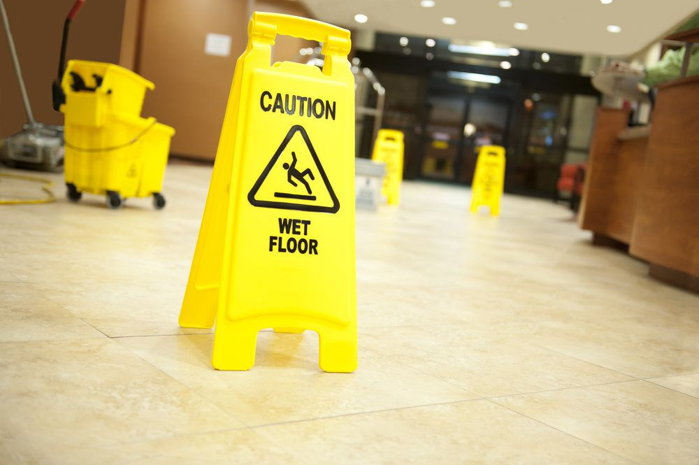 A wet floor sign in a lobby
