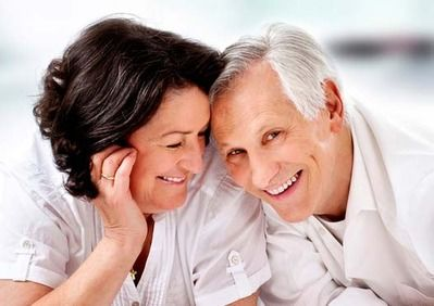 Laughing middle-aged couple with heads together
