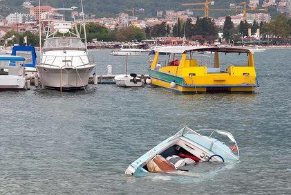 Motorboat sinking with moored boats in background