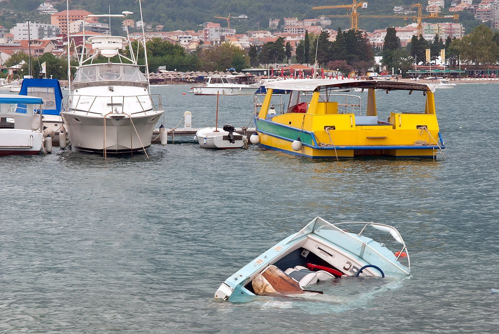 Boat sinking in harbor