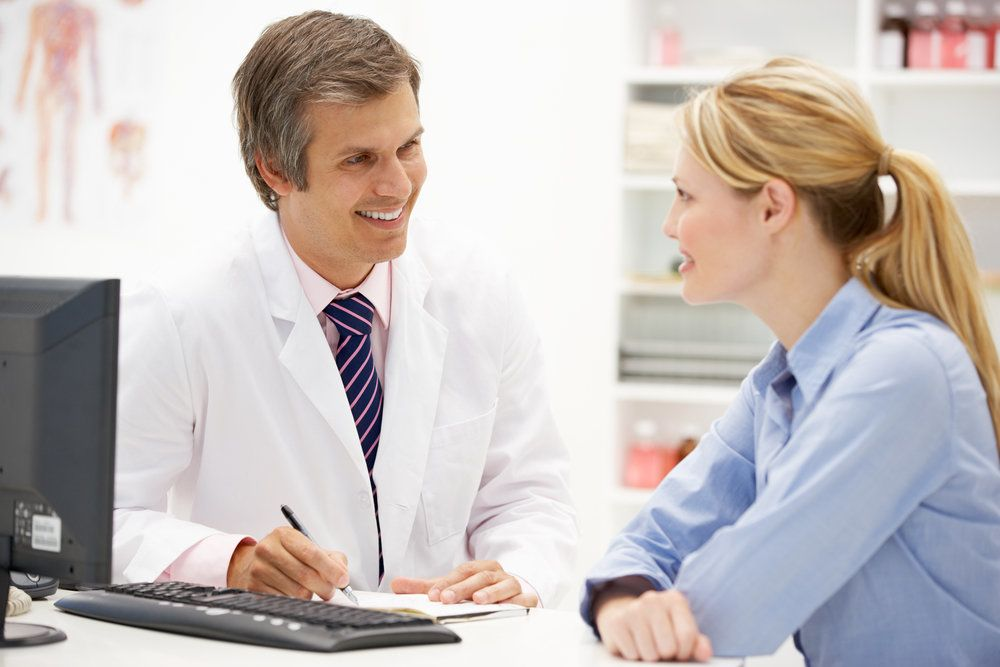 A female patient talking with a doctor