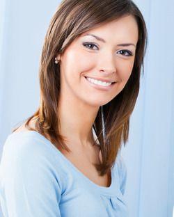 A beautiful young woman in a light blue shirt