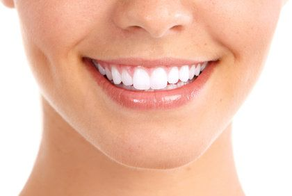 Attractive woman's smile with very white teeth