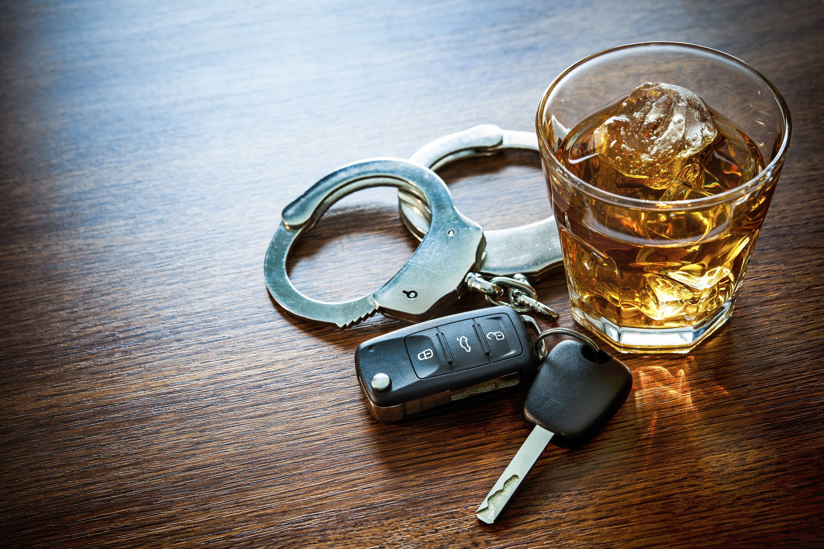 Alcohol, keys, and handcuffs
