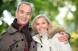 Couple smiling in woods