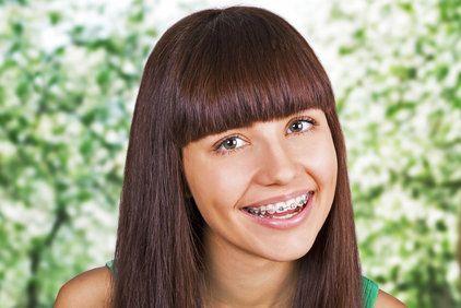 Portrait of smiling brunette wearing braces