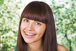 Smiling teenage girl with thick brown hair