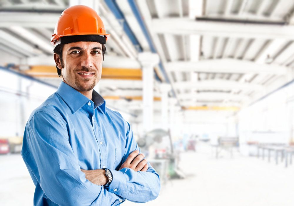 Smiling man in business shirt and hardhat