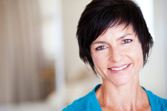 woman with stylish haircut smiles